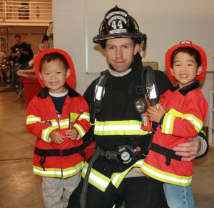 Michael loves pretending to be a firefighter.  It made his day to have a picture taken with a real fireman.