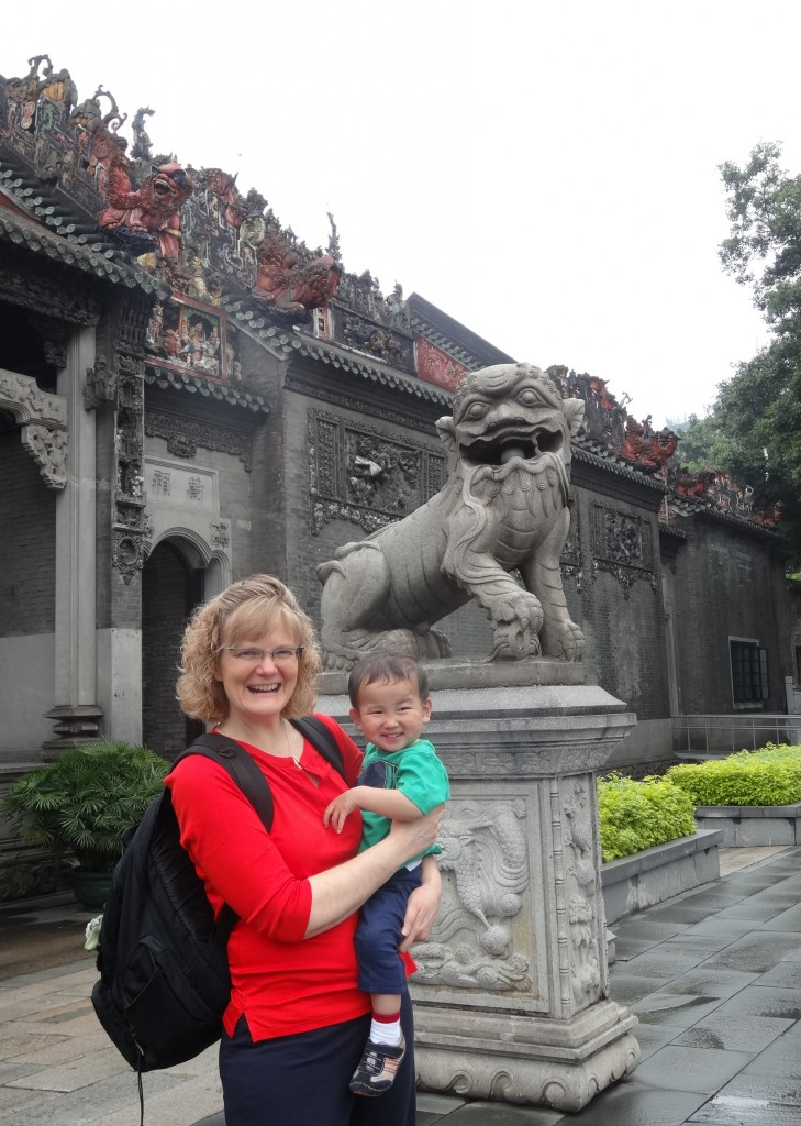 Mom and Max getting approval to enter from the Lion guarding the Chen Family temple.