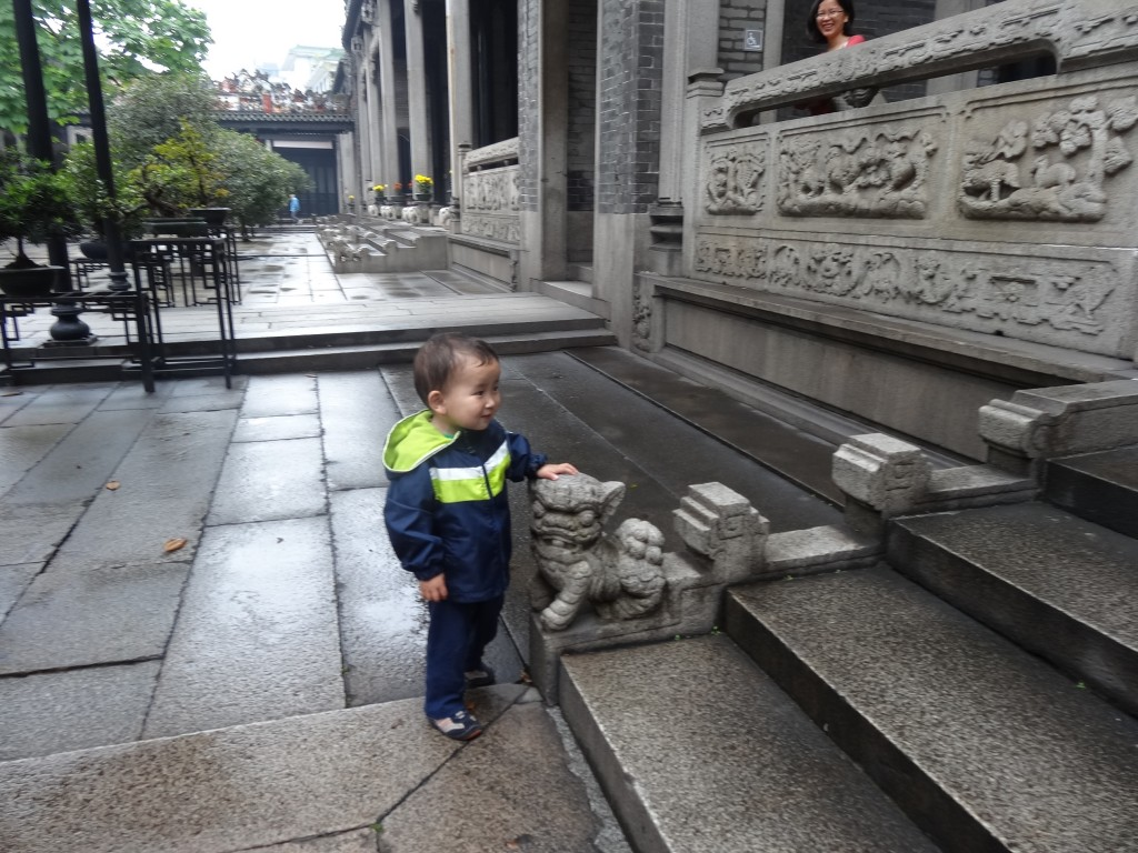 Max posing with one of the cub lions who was taking pride in guarding the steps inside the temple.
