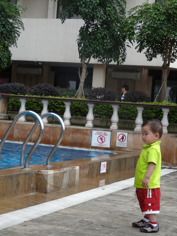 Max is not sure about the pool yet. What until he sees his brothers splashing around.