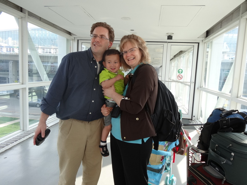 This is the third such picture of Michelle, Stefan and [ENTER CHILDS NAME] arriving at O'Hare after a trans-Pacific flight.