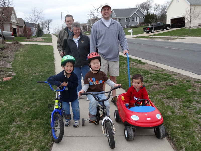 The three boys and grandparents on Max's first adventure to the neighborhood park.