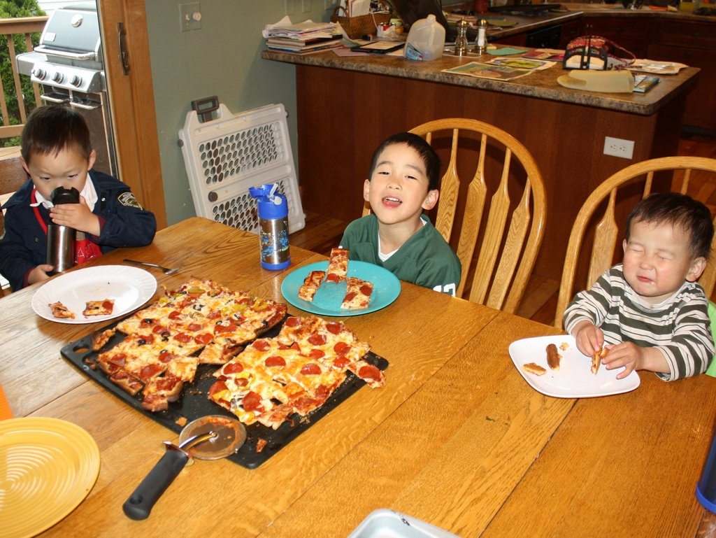 And the reward for the wait.  As you can see Max is not too keen on Pizza yet (but he did love the crust)